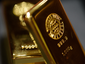 Gold drops below $2,000 as dollar holds gains and equities bounce