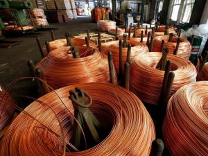 Demand cheer helps copper hold near 26-month peak