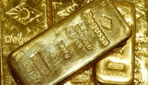 Gold slides 3% on strong dollar, stimulus concerns; silver tumbles