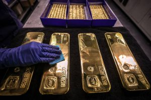 JPMorgan says sell gold volatility on 'non-conflicting' Trump health reports
