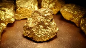 Gold prices holding above $1,900 as U.S. unemployment claims drop more than expected