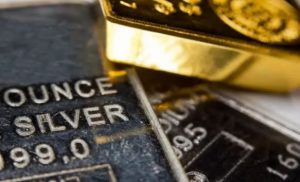 Gold, silver see price advances and greenback backs down