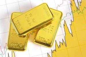 Gold Fluctuates With Traders Watching Dollar, Stimulus Talks